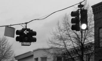 Greyscale photo of traffic lights